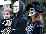 *PREMIUM EXCLUSIVE* **NO WEB, MUST CALL FOR PRICING** Los Angeles, CA - Hollywood couple Eva Mendes and Ryan Gosling get in the Halloween spirit and take out baby Esmeralda out for her first Halloween as a family of Skeletons.  Ryan wore a mask while Eva painted her face scary to match her baby girl Esmeralda whom we are seeing for the first time.  The trio did some Trick or Treating in the neighborhood with family and close friends for fun and eventful evening as a family.\\n\\nAKM-GSI           November 2, 2015\\n\\n**MUST CALL FOR PRICING**\\n\\nTo License These Photos, Please Contact :\\n \\n Steve Ginsburg\\n (310) 505-8447\\n (323) 423-9397\\n steve@akmgsi.com\\n sales@akmgsi.com\\n \\n or\\n \\n Maria Buda\\n (917) 242-1505\\n mbuda@akmgsi.com\\n ginsburgspalyinc@gmail.com
