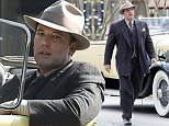 Picture Shows: Ben Affleck  November 02, 2015\n \n American actor Ben Affleck is spotted filming scenes for 'Live By Night' in Brunswick, Georgia. \n \n Ben is directing and acting in the new Prohibition era crime drama and was seen driving a classic car in full retro costume that included a beige fedora and a pinstripe suit.\n \n Non Exclusive\n UK RIGHTS ONLY\n \n Pictures by : FameFlynet UK © 2015\n Tel : +44 (0)20 3551 5049\n Email : info@fameflynet.uk.com
