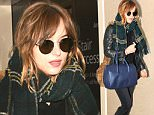 Picture Shows: Dakota Johnson  November 02, 2015\n \n 'Fifty Shades Darker' star Dakota Johnson departs on a flight from LAX in Los Angeles, California. On Sunday, she was turning heads at the Hollywood Film Awards in a sheer dress. \n \n Non Exclusive\n UK RIGHTS ONLY\n \n Pictures by : FameFlynet UK © 2015\n Tel : +44 (0)20 3551 5049\n Email : info@fameflynet.uk.com