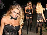 Beverly Hills, CA - Charlotte McKinney walks with a whip in her mouth as she arrives to the Casa Amigos Halloween party tonight.  The sexy model is over the top in her lingerie costume.\nAKM-GSI      October 30, 2015\nTo License These Photos, Please C