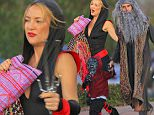 Kate Hudson wore a black and red ninja outfit for a Halloween party in Malibu.  The actress was accompanied by her children and ex Matt Bellamy.  Saturday, October 31, 2015 X17online.com