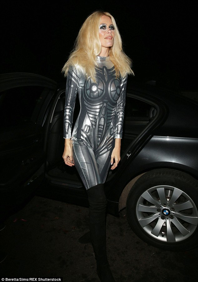 Timeless beauty:Claudia Schiffer showed off her amazing physique in a futuristic catsuit as she arrived at the Halloween party