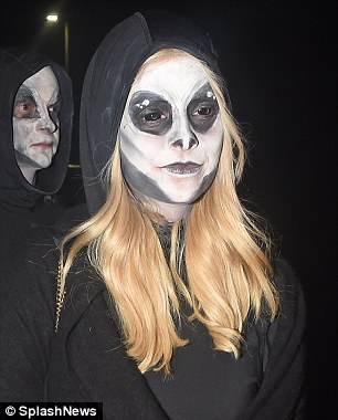 Skeltetal style: On Saturday night Holly Willoughby cut a very different figure, as she arrived at Jonathan Ross' Halloween party in a spooky skeletal outfit alongside her husband Dan Baldwin