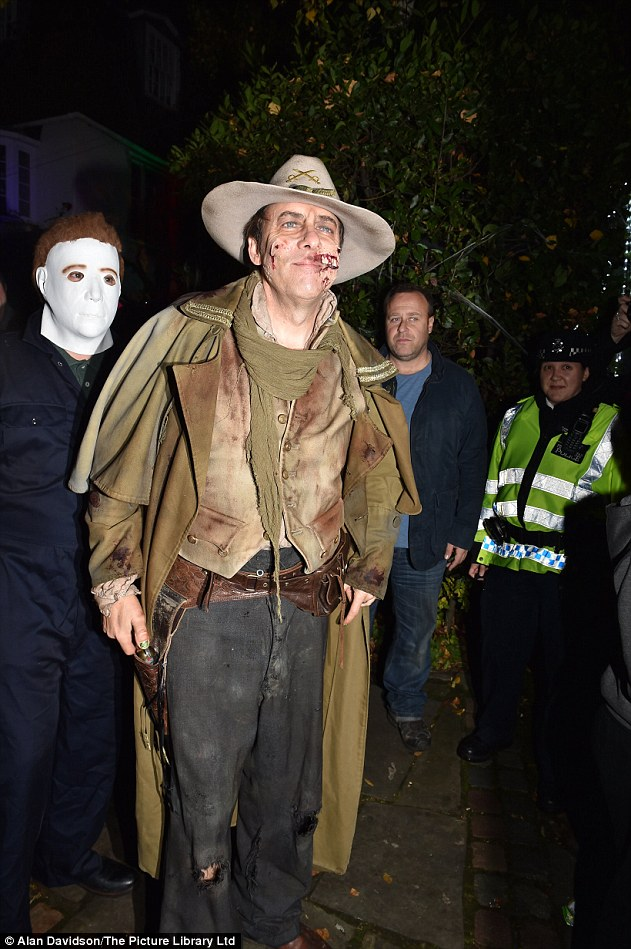 Host: Jonathan Ross led the way on Saturday night with a terrifying bloodied cowboy costume as he prepared to welcome his celeb pals to his haunted house bash