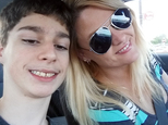 In this undated selfie, Alex Hoover, left, poses for a photo with his mother, Rene. Alex Hoover, an Alabama teen with a terminal heart condition has not returned to school after a spate of hospitalizations because of what his mother says is a dispute with school officials about how he might die. (Rene Hoover via AP)