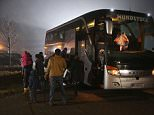 SUMTE, GERMANY - NOVEMBER 02:  Migrants seeking asylum in Germany arrive by bus at a former office park that has become short-term accommodation for migrants on November 2, 2015 in Sumte, Germany. Sumte, a farming village located southwest of Hamburg, has a population of 102, and starting later today it is to receive 500 migrants who will be housed in an abandoned office park on the village edge. The number of migrants at the shelter could reach up to 750 in coming weeks as Germany struggles to accommodate the unrelenting flood of migrants arriving at a rate of thousands per day. Authorities are distributing migrants seeking asylum in Germany at shelters nationwide, both in urban centers and in small, rural communities.  (Photo by Sean Gallup/Getty Images)