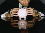 Businessman with Piggy Bank. Coin Bank rights managed
