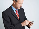 A stock photo of a businessman messaging.    Image shot 2008. Exact date unknown.