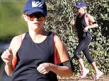 UK CLIENTS MUST CREDIT: AKM-GSI ONLY EXCLUSIVE: Brentwood, CA - Reese Witherspoon went for a jog this morning around Brentwood. The actress wore a pink sports bra with all black as she got her workout in for the day.  Pictured: Reese Witherspoon Ref: SPL1168484  031115   EXCLUSIVE Picture by: AKM-GSI / Splash News