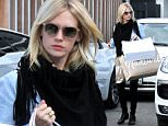 West Hollywood, CA - Actress January Jones looks refreshed and rejuvenated after a trip to Meche Salon this afternoon.  January walked out with handful of Madewell shopping bags and noticeably still wearing a ring on her ring finger after a recent split with Will Forte.  January also just posted a few cryptic photos on her Instagram account of herself in a bathtub last night, inspired by Ricky Gervais' bathtub selfies.\n  \nAKM-GSI     November 4,  2015\nTo License These Photos, Please Contact :\nSteve Ginsburg\n(310) 505-8447\n(323) 423-9397\nsteve@akmgsi.com\nsales@akmgsi.com\nor\nMaria Buda\n(917) 242-1505\nmbuda@akmgsi.com\nginsburgspalyinc@gmail.com