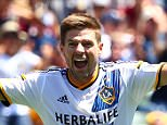 LOS ANGELES, CA - AUGUST 23:  Steven Gerrard #8 of Los Angeles Galaxy reacts to a goal by teammate Sebastian Lletget #17 as Jason Hernandez #2 and Ned Grabavoy #11 of New York City FC look on in the second half during their MLS match at StubHub Center on August 23, 2015 in Los Angeles, California. The Galaxy defeated NYCFC 5-1.  (Photo by Victor Decolongon/Getty Images)