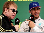 AUSTIN, TX - OCTOBER 25:  Lewis Hamilton of Great Britain and Mercedes GP celebrates on the podium with Elton John after winning the United States Formula One Grand Prix and the championship at Circuit of The Americas on October 25, 2015 in Austin, United States.  (Photo by Lars Baron/Getty Images)