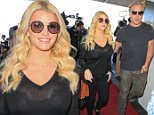 Jessica Simpson arrives at LAX looking stellar as the buxom blonde catches a flight to New York City. Jessica was wearing a sheer black top while accompanied by hubby Eric Johnson. November 6, 2015. X17online.com