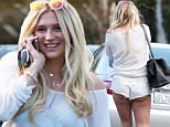 144585, EXCLUSIVE: Kesha attends a couple of meetings before grabbing a late lunch with a male friend in LA. After lunch they left together in her car. Kesha exited one of her meeting in good spirits with arms held up and smiling. Los Angeles, California - Wednesday November 4, 2015. Photograph: © PacificCoastNews. Los Angeles Office: +1 310.822.0419 sales@pacificcoastnews.com FEE MUST BE AGREED PRIOR TO USAGE