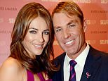 Elizabeth Hurley and Shane Warne Have Shane Warne & Liz Hurley Split? Shane Warne and Elizabeth Hurley are the latest stars to enter the romance rumour wheel, as sources suggest the couple have split.   Reporters have been quick to note that the couple have failed to mention each other in their recent Twitter updates. Something that is reportedly frequent.    The Australian cricketer and English actress have been dating since 2010. Announcing their engagement in 2011.    For more information visit http://www.rexfeatures.com/stacklink/KKQOKEJCJ Mandatory Credit: Photo by REX/Richard Young (1899027h)