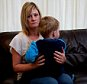 **MOTHER DOES NOT WANT THE CHILD TO BE IDENTIFIED AND REQUESTED PICTURES TO BE PIXILATED** FILE PICTURE - Kerrie Coniff at her home in Birmingham with her son Billy who had a 'miracle' escape when he fell 20ft out of nursery window.  See NTI story NTIFALL.  A boy of two had a miracle escape when he plunged 12ft from an open window onto paving slabs at a Birmingham nursery.  Billy Coniff cheated death because he landed on his feet instead of his head ñ and a nursery nurse grabbed a second child to stop him falling from the same first floor window.  It happened at Munchkins Nursery in Longmeadow Crescent, Shard End, Birmingham, on September 23, 2013.  Now boss Suzanne Holmes has been ordered to pay a total of £16,500 in fines and costs after she admitted failing to discharge her duties under the Health and Safety at Work Act 1974.