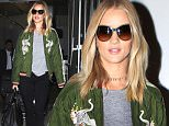 Picture Shows: Rosie Huntington-Whiteley  November 06, 2015\n \n Model and actress Rosie Huntington-Whiteley arriving on a flight at LAX airport in Los Angeles, California. The Victoria's Secret Angel was looking stylish in a green bomber jacket, black skinny jeans, and black ankle boots.\n \n Non Exclusive\n UK RIGHTS ONLY\n \n Pictures by : FameFlynet UK © 2015\n Tel : +44 (0)20 3551 5049\n Email : info@fameflynet.uk.com