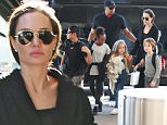 Picture Shows: Angelina Jolie  November 06, 2015\n \n Actress and busy mom Angelina Jolie departing on a flight at LAX airport in Los Angeles, California with her children. The 'By the Sea' star was looking chic for her flight in an all black ensemble.\n \n Exclusive All Rounder\n UK RIGHTS ONLY\n FameFlynet UK © 2015\n Tel : +44 (0)20 3551 5049\n Email : info@fameflynet.uk.com