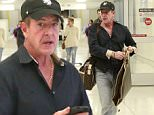 EXCLUSIVE: Michael Lohan arrives in Los Angeles days after losing custody of his children & as reports of domestic violence swirl with estranged wife, Kate Major.  Lindsay Lohan's controversial father was seen with his limo driver at LAX.\n\nPictured: Michael Lohan\nRef: SPL1171588  071115   EXCLUSIVE\nPicture by: Splash News\n\nSplash News and Pictures\nLos Angeles: 310-821-2666\nNew York: 212-619-2666\nLondon: 870-934-2666\nphotodesk@splashnews.com\n