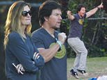 Mark Wahlberg and his wife Rhea Durham were seen at their son's soccer game in Woodland Hills, CA. Mark was quite animated on the field jumping up and down and making gestures. When not wrapped up in the game, Mark enjoyed some pineapples, strawberries and water.\n\nPictured: Rhea Durham, Mark Wahlberg\nRef: SPL1171412  071115  \nPicture by: Lauren / Splash News\n\nSplash News and Pictures\nLos Angeles: 310-821-2666\nNew York: 212-619-2666\nLondon: 870-934-2666\nphotodesk@splashnews.com\n
