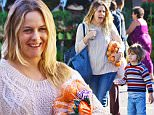 EXCLUSIVE: Clueless star Alicia Silverstone shopped for fresh produce at the Studio City Farmers Market. Alicia was accompanied by her son Bear Blu Jarecki during the trip. Alicia also was seen carrying a white Cruelty Free Vegan reusable bag during her shopping trip. Alicia was wearing a tan knitted sweater, blue jeans and black Converse sneakers.\n\nPictured: Alicia Silverstone\nRef: SPL1170712  081115   EXCLUSIVE\nPicture by: Boggs / Splash News\n\nSplash News and Pictures\nLos Angeles: 310-821-2666\nNew York: 212-619-2666\nLondon: 870-934-2666\nphotodesk@splashnews.com\n