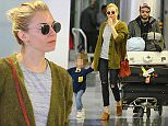 EXCLUSIVE ALL ROUNDER Sienna Miller is seen arriving with her fiancÈ Tom Sturridge and their daughter Marlowe at Newark airport in New York, on November 4th 2015.\n5 November 2015.\nPlease byline: Vantagenews.com\nUK clients should be aware children's faces may need pixelating.