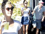 UK CLIENTS MUST CREDIT: AKM-GSI ONLY\nEXCLUSIVE: Venice, CA - Hollywood couple Leonardo DiCaprio and Kelly Rohrbach seen arriving at hot spot Gjelina Take Away in Venice. Leo steps out of his brand new Tesla wearing ripped off baggy shorts showing his blue underwear! His blonde lady looked flawless as usual, wearing a white top with a denim skirt showing off her long legs.\n\nPictured: Leonardo DiCaprio and Kelly Rohrbach\nRef: SPL1173848  101115   EXCLUSIVE\nPicture by: AKM-GSI / Splash News\n\n