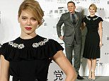 """British actor Daniel Craig and French actress Lea Seydoux pose for photographers before a press conference for the movie """"Spectre"""" in Beijing, Tuesday, Nov. 10, 2015. The film, the latest in the James Bond franchise, opens in China on Friday. (AP Photo/Mark Schiefelbein)"""