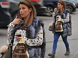 Coleen Rooney spotted in Alderley Edge, Cheshire. The WAG who was carrying a plastic bag from the Ole Swwet Shop after picking some treats for the kids. \n\n12/11/2015\n\n******NON EXCLUSIVE****\n\n\n\n
