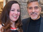 Hollywood star George Clooney in Edinburgh outside Tiger Lily restaurant with raffle winner Heather McGowan. Pic Jeff Holmes
