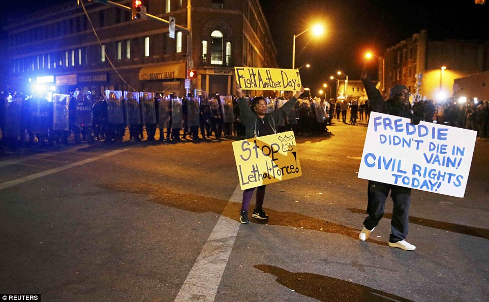 Fight another day: One protester holds up a sign saying 'fight another day'. The other side of the woman's sign said 'go home'