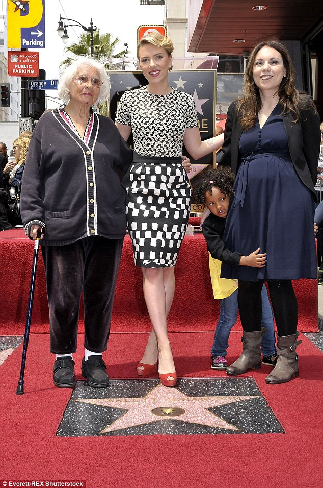 Honoured: Scarlett with her mom and grandmother as she received her star on the Hollywood Walk Of Fame