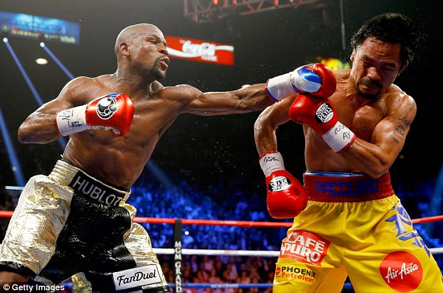 Floyd Mayweather (left) throws a punch at Manny Pacquiao during their big bout in Las Vegas on Saturday