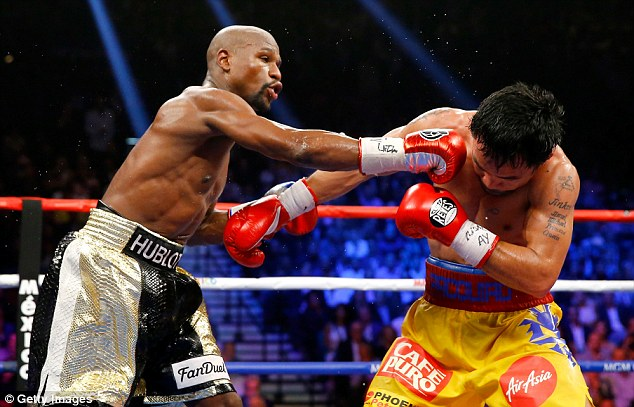 Mayweather catches Pacquiao before going on to claim a unanimous decision on points
