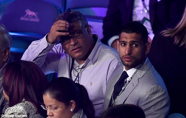 Amir Khan (right) was in attendance at the MGM Grand on Saturday to watch Mayweather vs Pacquiao