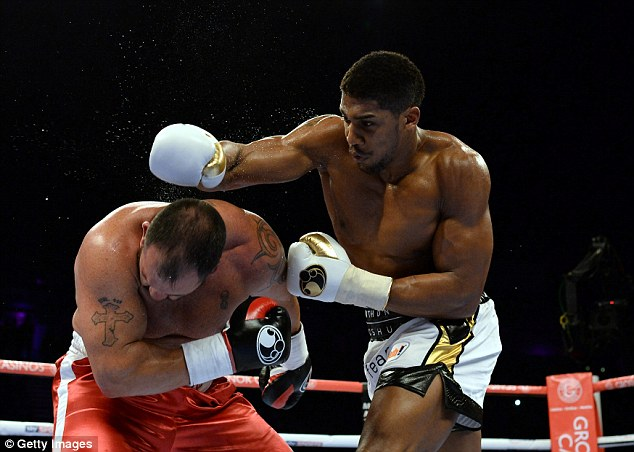 Anthony Joshua (right) in action against Jason Gavern during a heavyweight bout in Newcastle last month