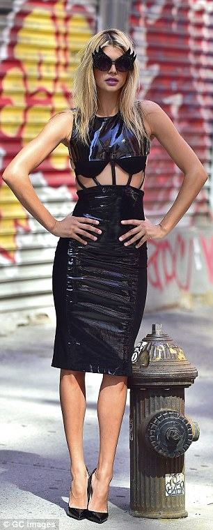 The 24-year-old-model, who is Leonardo Di Caprio's latest squeeze, showed off exactly what is getting the actor's pulse racing in a racy dominatrix inspired outfit
