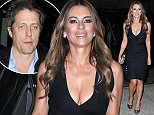 Elizabeth Hurley shows off her cleavage in a fitted black dress while out in New York City tonight.  Pictured: Liz Hurley, Elizabeth Hurley Ref: SPL1174991  111115   Picture by: Splash News  Splash News and Pictures Los Angeles: 310-821-2666 New York: 212-619-2666 London: 870-934-2666 photodesk@splashnews.com