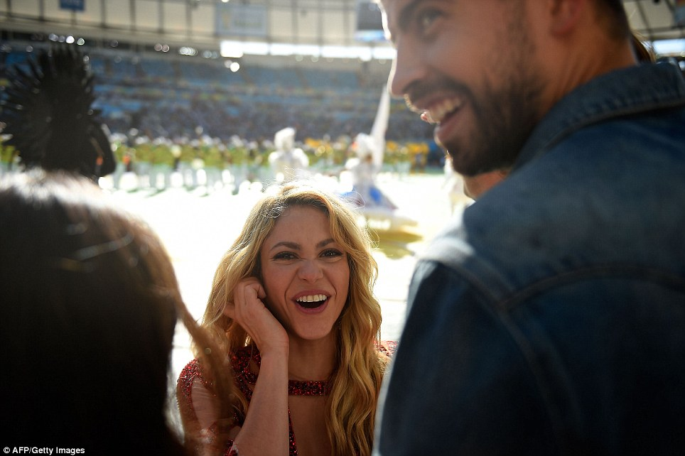 Excited: Shakira (centre) and her partner Barcelona's Gerard Pique (right) smile during the closing ceremony of the 2014 World Cup on Sunday at the Maracana