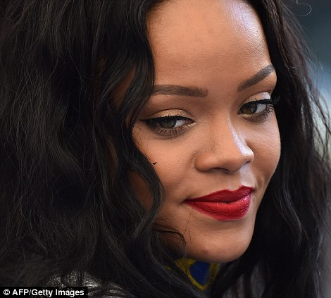 Looking forward: Rihanna takes her place in the crowd for the 2014 World Cup final with her fellow celebrities