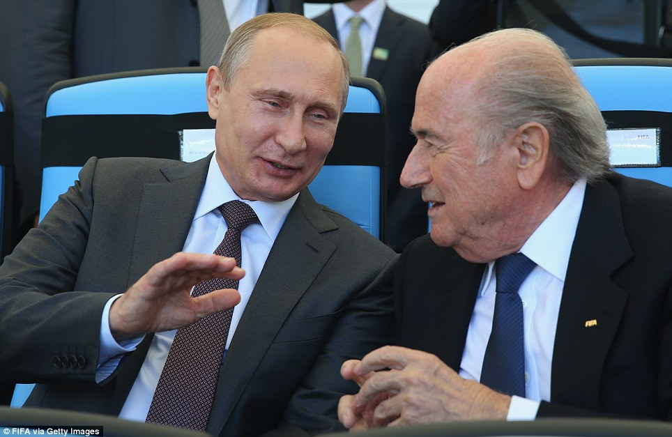 Chat: FIFA President Blatter talks with Russian President Vladimir Putin (left) ahead of the World Cup final 2014 in Brazil
