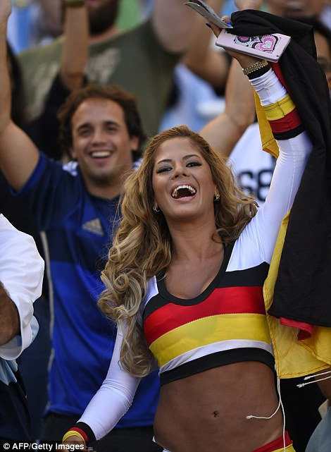 Celebration time: A Germany fan enjoys the festivities ahead of the final against Argentina on Sunday