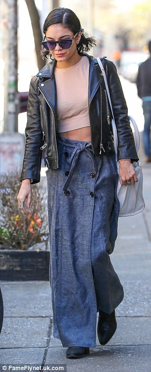 Retro look: Vanessa was channeling the 90s in her baggy denim skirt and tiny crop top