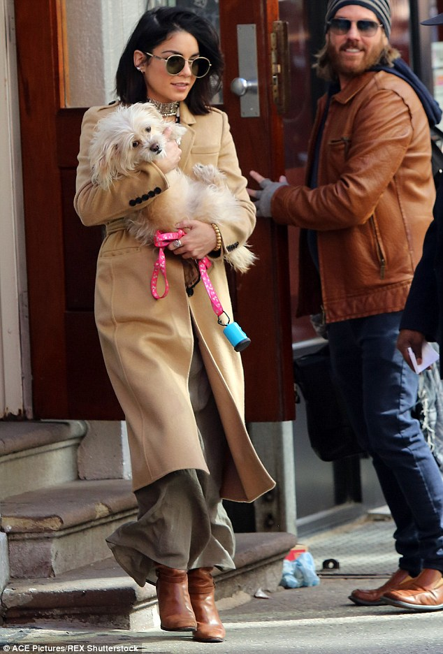 Her little one: The former Disney star's dog was outfitted with a cute pink leash