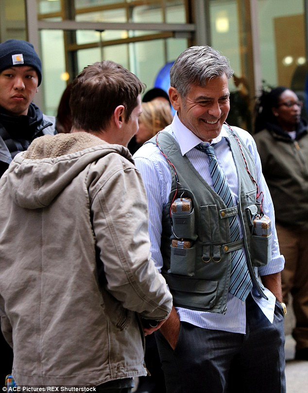 The jokesters of Wall Street: Jack O'Connell and George Clooney shared a laugh as they shot scenes for Money Monster in the heart of New York's financial district on Friday