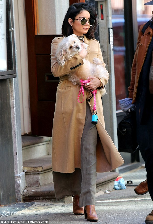 They call it puppy love! The 26-year-old cradled her dog Darla while stepping out into New York on Friday