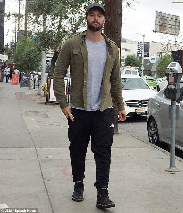 Looking sad: Patrick Schwarzenegger appears downcast while arriving at Joan's On Third in Los Angeles on Friday