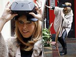 LONDON, UNITED KINGDOM - NOVEMBER 13:  Kate Garraway seen in Leicester Square wearing an augmented reality headset on November 13, 2015 in London, England. (Photo by Alex B. Huckle/GC Images)