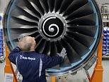A worker scrubs the turbine of an aircraft jet engine at the Rolls-Royce aircraft engine factory in Berlin, Germany.  The factory, a greenfield project built in 1993 in what was East Germany before 1989, produces jet engines for aircraft makers including Airbus and Boeing. The plant's production is also typical of the high-tech exports that make the Germany the world's biggest exporter.    BERLIN - AUGUST 23:   (Photo by Sean Gallup/Getty Images)