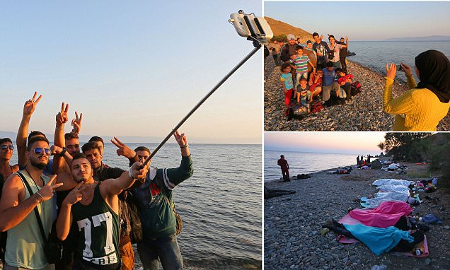 Refugees celebrate on Lesbos beach by taking a selfie after reaching Greek island